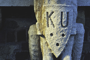 "Grotesque with ""KU"" shield"